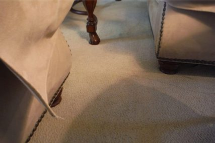 Electric cord is successfully hidden under carpet and furniture moved back into place